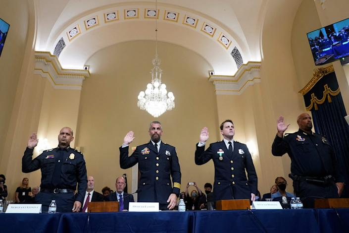 From left, U.S. Capitol Police Sgt. Aquilino Gonell, D.C. Metropolitan Police Department officer Michael Fanone, D.C. Metropolitan Police Department officer Daniel Hodges and Capitol Police Pvt. 1st Class Harry Dunn are sworn in July 27 before members of a congressional committee investigating the attack on the U.S. Capitol on Jan. 6.