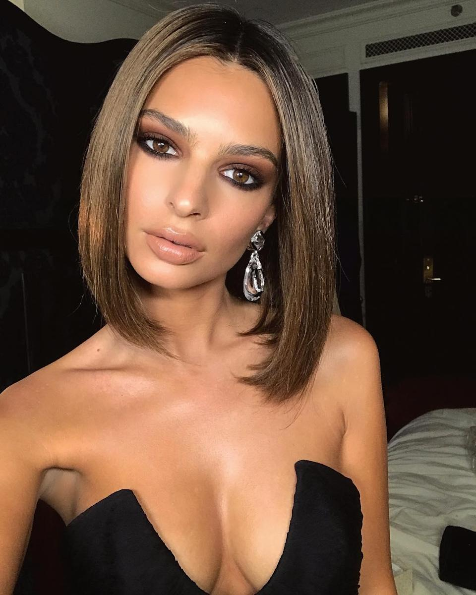 """For a fancy event (remember those?) channel Emily Ratajkowski with a flipped-under lob. Keep things sleek with a shine spray like <a href=""""https://shop-links.co/1718848595102363610"""" rel=""""nofollow noopener"""" target=""""_blank"""" data-ylk=""""slk:Drybar's Sparkling Soda"""" class=""""link rapid-noclick-resp"""">Drybar's Sparkling Soda</a>."""