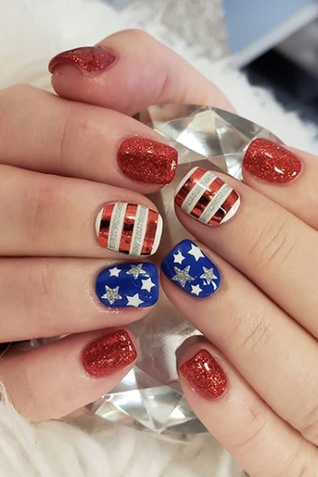 """<p>The more glitter and metallic shine, the better ... that's <a href=""""https://www.goodhousekeeping.com/holidays/g4395/fourth-of-july-quotes/"""" rel=""""nofollow noopener"""" target=""""_blank"""" data-ylk=""""slk:America's motto"""" class=""""link rapid-noclick-resp"""">America's motto</a>, isn't it?</p><p><a class=""""link rapid-noclick-resp"""" href=""""https://www.amazon.com/Metallic-Holographic-Chevron-Pattern-Striping/dp/B01HIXU2G8/?tag=syn-yahoo-20&ascsubtag=%5Bartid%7C10055.g.1278%5Bsrc%7Cyahoo-us"""" rel=""""nofollow noopener"""" target=""""_blank"""" data-ylk=""""slk:SHOP METALLIC TAPE"""">SHOP METALLIC TAPE</a></p><p><em><a href=""""https://www.instagram.com/p/BkAy3vrBKtK/?taken-by=nailsbybrianalv"""" rel=""""nofollow noopener"""" target=""""_blank"""" data-ylk=""""slk:See more on Nails by Briana LV»"""" class=""""link rapid-noclick-resp"""">See more on Nails by Briana LV»</a></em> </p>"""