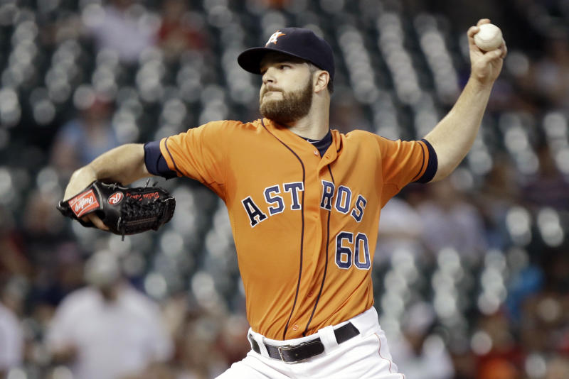 Houston Astros' Dallas Keuchel delivers a pitch against the Los Angeles Angels in the first inning of a baseball game Friday, Sept. 13, 2013, in Houston. (AP Photo/Pat Sullivan)
