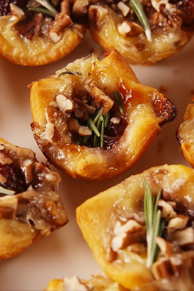 """<p>These little guys are the perfect appetiser. Be warned: It'll forever change the way you think about brie. </p><p>Get the <a href=""""https://www.delish.com/uk/cooking/recipes/a29664090/cranberry-brie-bites-recipe/"""" target=""""_blank"""">Cranberry Brie Bites</a> recipe. </p>"""