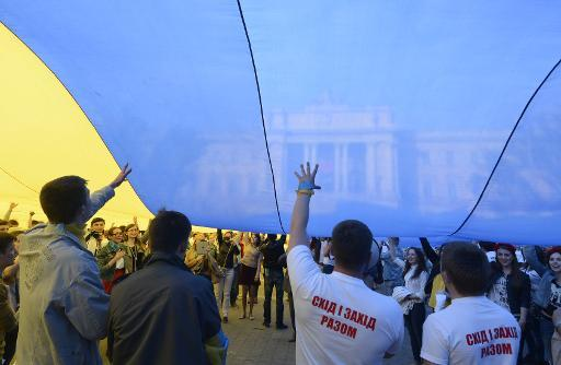 Students hold a massive Ukrainian flag during an action in the city of Lviv on May 2, 2014