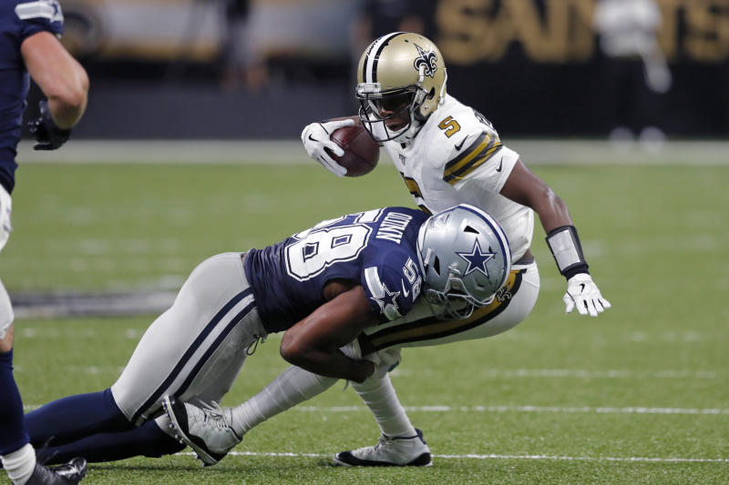 Robert Quinn amassed 11.5 sacks in his lone season with the Dallas Cowboys. Now he is reportedly headed to the Chicago Bears on a five-year deal. (AP Photo/Bill Feig)
