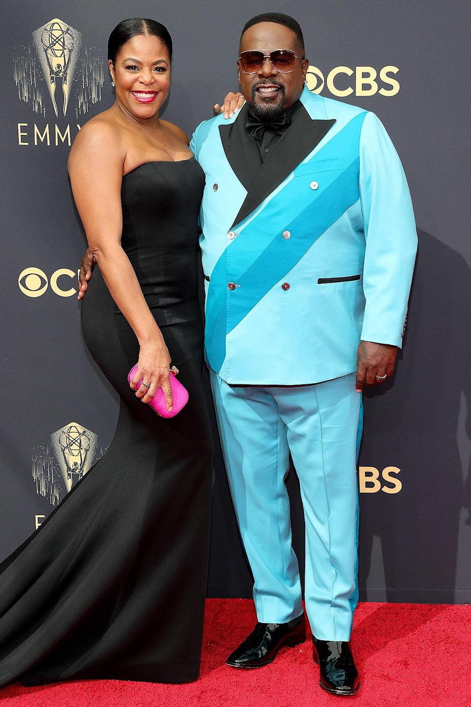 <p>The night's host and his wife brought some fun pops of color to the red carpet. </p>
