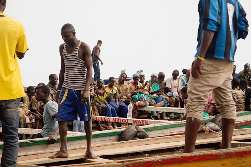 Burundian refugees are seen on boats on their way to Kigoma, Tanzania on May 25, 2015