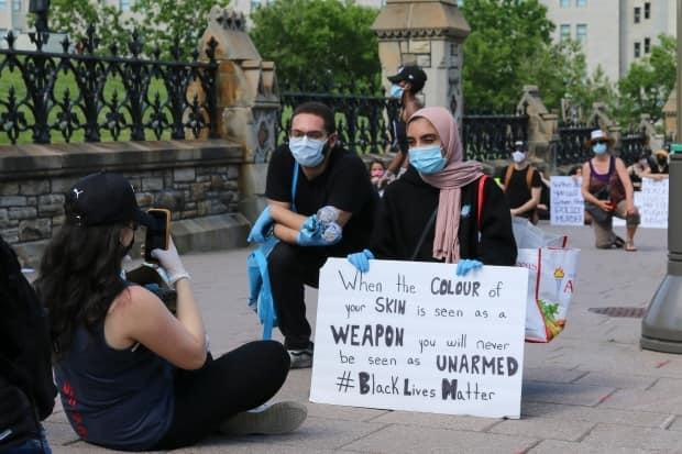 Award-winning Inuk photographer Katherine Takpannie chose this picture from the Black Lives Matter rally on Parliament Hill as her quintessential COVID-19 photo.