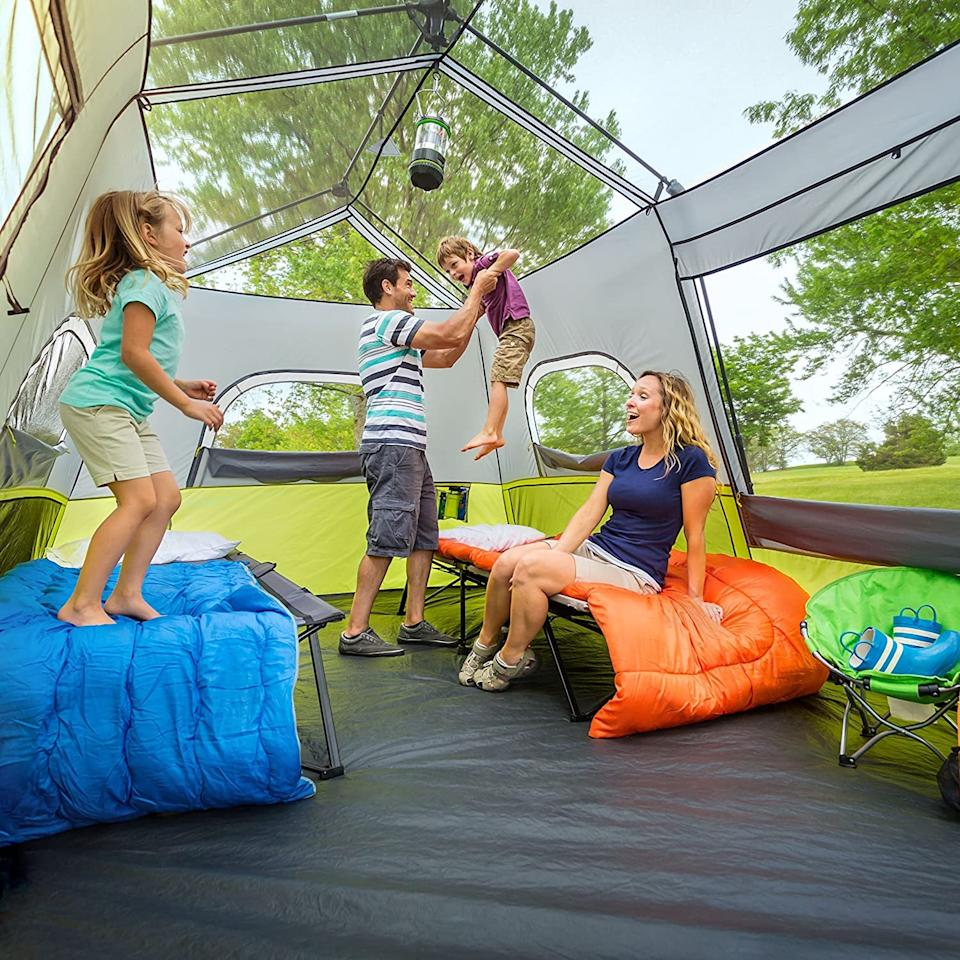 "<p>This large <a href=""https://www.popsugar.com/buy/CORE-9-Person-Instant-Cabin-Tent-584336?p_name=CORE%209%20Person%20Instant%20Cabin%20Tent&retailer=amazon.com&pid=584336&price=270&evar1=savvy%3Auk&evar9=47585582&evar98=https%3A%2F%2Fwww.popsugar.com%2Fsmart-living%2Fphoto-gallery%2F47585582%2Fimage%2F47585726%2FCORE-9-Person-Instant-Cabin-Tent&list1=travel%2Camazon%2Ccamping&prop13=api&pdata=1"" rel=""nofollow"" data-shoppable-link=""1"" target=""_blank"" class=""ga-track"" data-ga-category=""Related"" data-ga-label=""https://www.amazon.com/CORE-Person-Instant-Cabin-Tent/dp/B00VFH1RQS/ref=sr_1_7?dchild=1&amp;keywords=camping+tents&amp;qid=1593017079&amp;sr=8-7"" data-ga-action=""In-Line Links"">CORE 9 Person Instant Cabin Tent</a> ($270) features a removable roof for an airy feel.</p>"