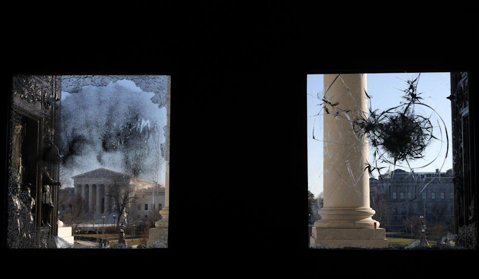 The US Supreme Court is seen through a damaged entrance of the Capitol building on Thursday. Photo: Getty Images/AFP