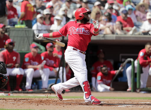 FILE - In this Feb. 24, 2018, file photo, Philadelphia Phillies' Carlos Santana bats during the first inning of a baseball spring exhibition game against the Baltimore Orioles, in Clearwater, Fla. The Phillies signed veteran slugger Carlos Santana away from Cleveland in December. (AP Photo/Lynne Sladky, File)