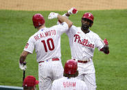 Philadelphia Phillies' Andrew McCutchen, right, celebrates with J.T. Realmuto after McCutchen hit a solo home run during the first inning of a baseball game, Tuesday, May 4, 2021, in Philadelphia. (AP Photo/Derik Hamilton)