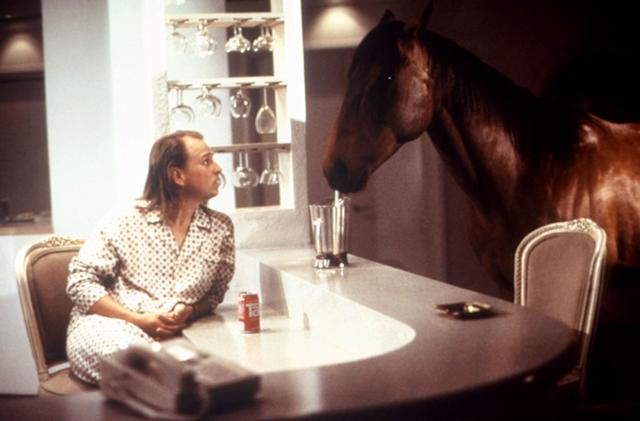 Goldthwait and Don share a meal in <em>Hot to Trot.</em>(Photo: Warner Bros.; courtesy Everett Collection)
