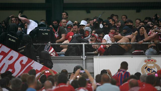 A quarter-final encounter in the Spanish capital was marred by scenes of violence between visiting supporters and security forces inside the stadium