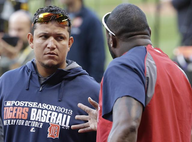 Detroit Tigers third baseman Miguel Cabrera talks with Boston Red Sox designated hitter David Ortiz, right, before a baseball workout at Fenway Park in Boston, Friday, Oct. 11, 2013. The Tigers face the Red Sox in Game 1 of the American League championship series on Saturday. (AP Photo/Charlie Riedel)
