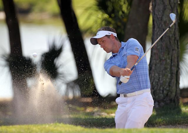 PALM HARBOR, FL - MARCH 17: Luke Donald of England plays a shot on the first hole during the third round of the Transitions Championship at the Innisbrook Resort and Golf Club on March 17, 2012 in Palm Harbor, Florida. (Photo by Sam Greenwood/Getty Images)