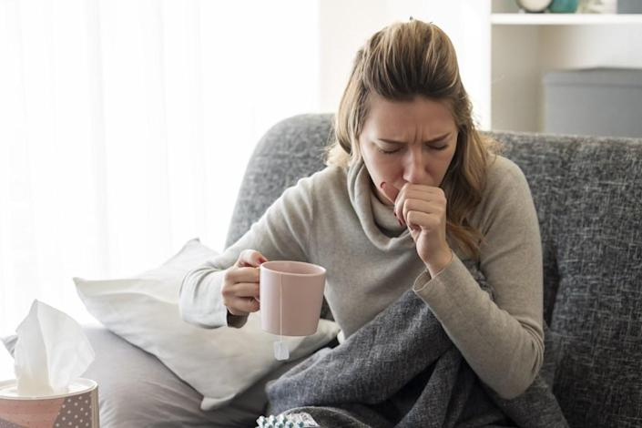 Sick woman with flu at home