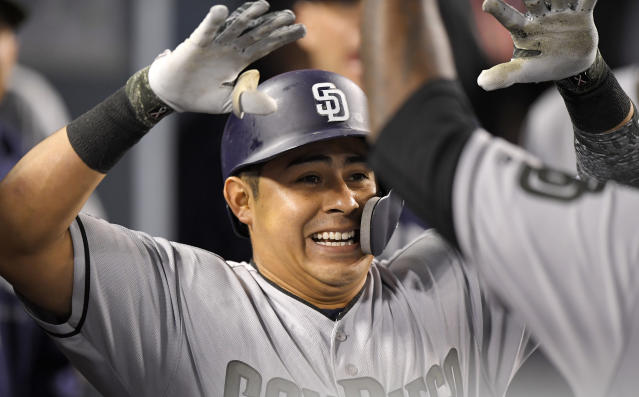 San Diego Padres' Christian Villanueva celebrates with teammates after hitting a solo home run during the eighth inning of a baseball game against the Los Angeles Dodgers on Saturday, May 26, 2018, in Los Angeles. (AP Photo/Mark J. Terrill)