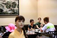 One Tokyo restaurant is using lifelike mannequins to help diners keep social distance and stop the business feeling empty (AFP Photo/Philip FONG)