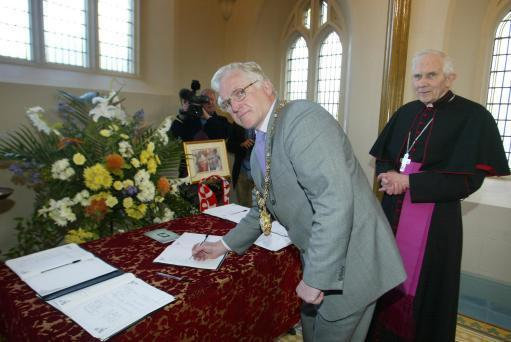 Bishop Patrick Walsh (right) – the detention giver – seen here signing a book of condolence for Pope John Paul II with Belfast Lord Mayor Tom Eakin (left)