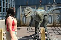 Natalie Lucia is confronted by Blue the velociraptor at Universal Studios Hollywood in California, which had been closed for more than a year