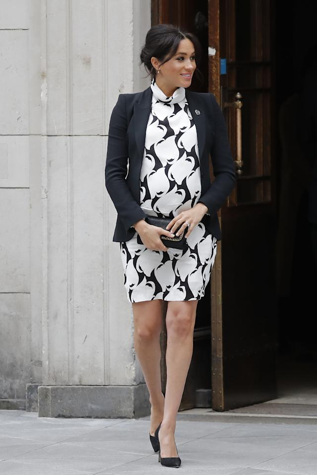 Meghan wore a sixties-inspired dress from Reiss with her Alexander McQueen blazer for an International Women's Day panel. She teamed it with Manolo Blahnik heels and a Stella McCartney clutch bag. [Photo: Getty]
