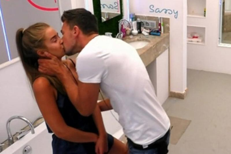 Rule breaking: Sam and Georgia share a kiss: ITV