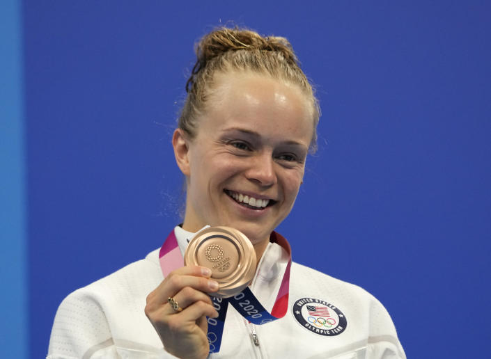 Krysta Palmer of the United States' pose for a photo after winning bronze medal in women's diving 3m springboard final at the Tokyo Aquatics Centre at the 2020 Summer Olympics, Sunday, Aug. 1, 2021, in Tokyo, Japan. (AP Photo/Dmitri Lovetsky)