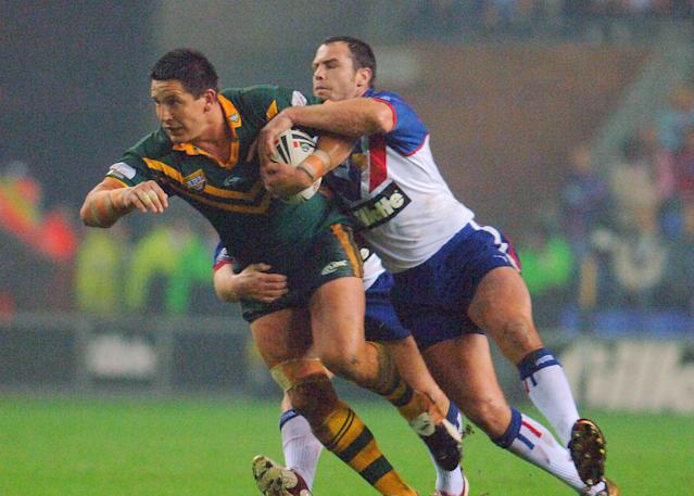 (FILES) In this November 5, 2005 file photo, Australia's Danny Buderus tries to shake off a tackle from the Great Britain defence during a Tri-Nations Rugby League match at the JJB Stadium in Wigan, England. Buderus took over as interim coach of the Newcastle Knights on July 27, 2015 after the Australian NRL strugglers sacked Rick Stone after a run of poor results. AFP Photo by Paul Barker (AFP Photo/PAUL BARKER)