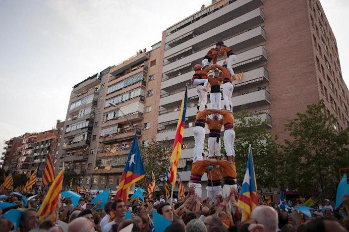 Members of a Casteller (human towers, built traditionally in festivals) perform during celebrations for Catalonia's National Day on September 11, 2015 in Barcelona (AFP Photo/Jorge Guerrero)