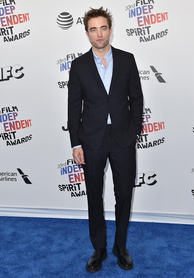 At the 2018 Film Independent Spirit Awards, in a classic navy suit and chunky derby shoes.