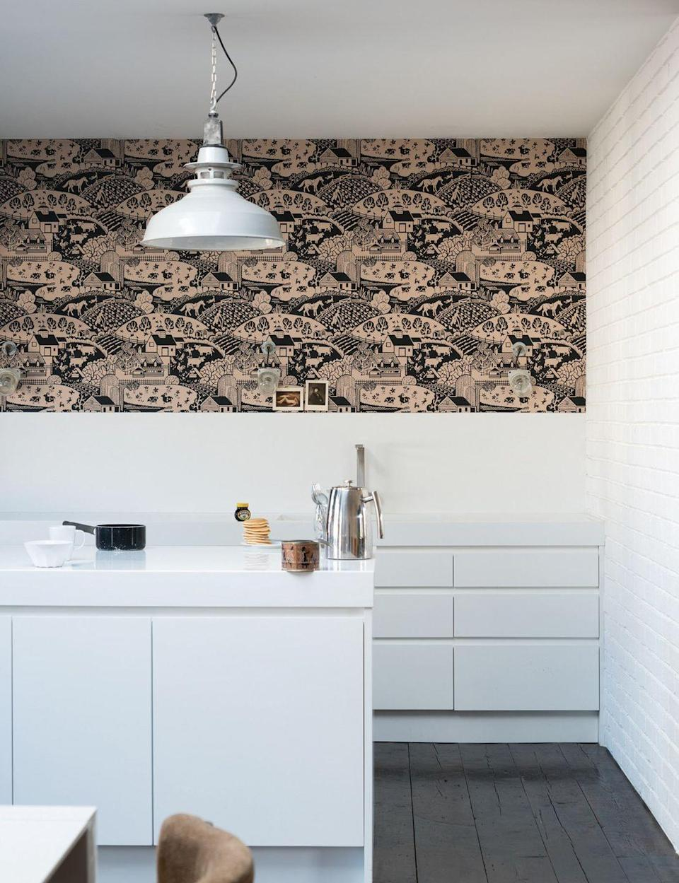 """<p>If you'd prefer to keep your white kitchen counters free of decoration and accessories, a feature wall is a great way to add some colour and texture. <a href=""""https://www.housebeautiful.com/uk/decorate/walls/g36616909/paste-the-wall-wallpaper/"""" rel=""""nofollow noopener"""" target=""""_blank"""" data-ylk=""""slk:Explore 13 paste the wall wallpapers for easy application"""" class=""""link rapid-noclick-resp"""">Explore 13 paste the wall wallpapers for easy application</a>.</p><p>Pictured: <a href=""""https://go.redirectingat.com?id=127X1599956&url=https%3A%2F%2Fwww.farrow-ball.com%2Fwallpaper%2Fgable&sref=https%3A%2F%2Fwww.housebeautiful.com%2Fuk%2Fdecorate%2Fkitchen%2Fg37409102%2Fwhite-kitchen%2F"""" rel=""""nofollow noopener"""" target=""""_blank"""" data-ylk=""""slk:Gable wallpaper at Farrow & Ball"""" class=""""link rapid-noclick-resp"""">Gable wallpaper at Farrow & Ball</a></p>"""