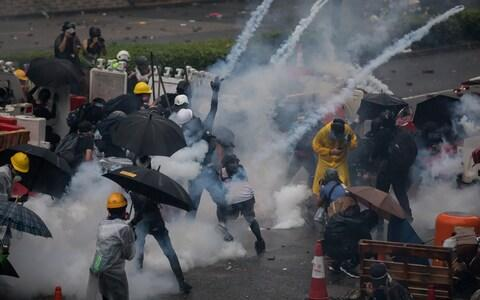 Tear gas lands among protesters in the Tsuen Wan district of Hong Kong on August 25 - Credit:  Paul Yeung/Bloomberg