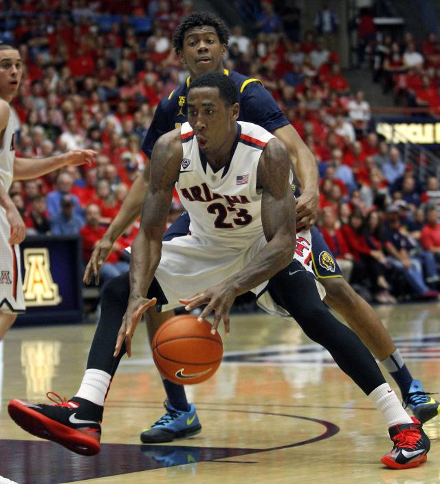 Arizona's Rondae Hollis-Jefferson (23) is pressured by California's Tyrone Wallace as he dribbles in the lane in the second half of an NCAA college basketball game on Wednesday, Feb. 26, 2014, in Tucson, Ariz. Arizona won 87-59. (AP Photo/John MIller)