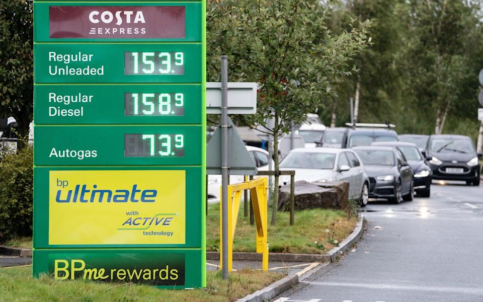 Cars queuing at a BP service station at Wetherby Services - PA