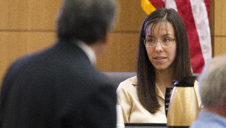 Prosecutor Juan Martinez cross examines Jodi Arias a during her trial in Maricopa County Superior Court, Tuesday, Feb. 26, 2013. Arias is on trial for the murder of her boyfriend, Travis Alexander, in 2008. (AP Photo/The Arizona Republic, Tom Tingle) MARICOPA COUNTY OUT; MAGS OUT; NO SALES