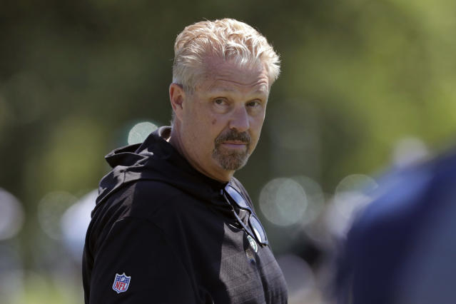 """FILE - In this June 4, 2019, file photo, New York Jets defensive coordinator Gregg Williams looks on as his players run drills at the team's NFL football training facility in Florham Park, N.J. Odell Beckham Jr. says former Browns defensive coordinator Gregg Williams instructed his players to """"take me out"""" of a preseason game in 2017. The Pro Bowl wide receiver sustained an ankle injury when Cleveland's Briean Boddy-Calhoun cut his legs out while he was with the New York Giants. Beckham said current Cleveland players told him that Williams instructed them to """"take me out of the game, and it's preseason."""" (AP Photo/Julio Cortez, File)"""