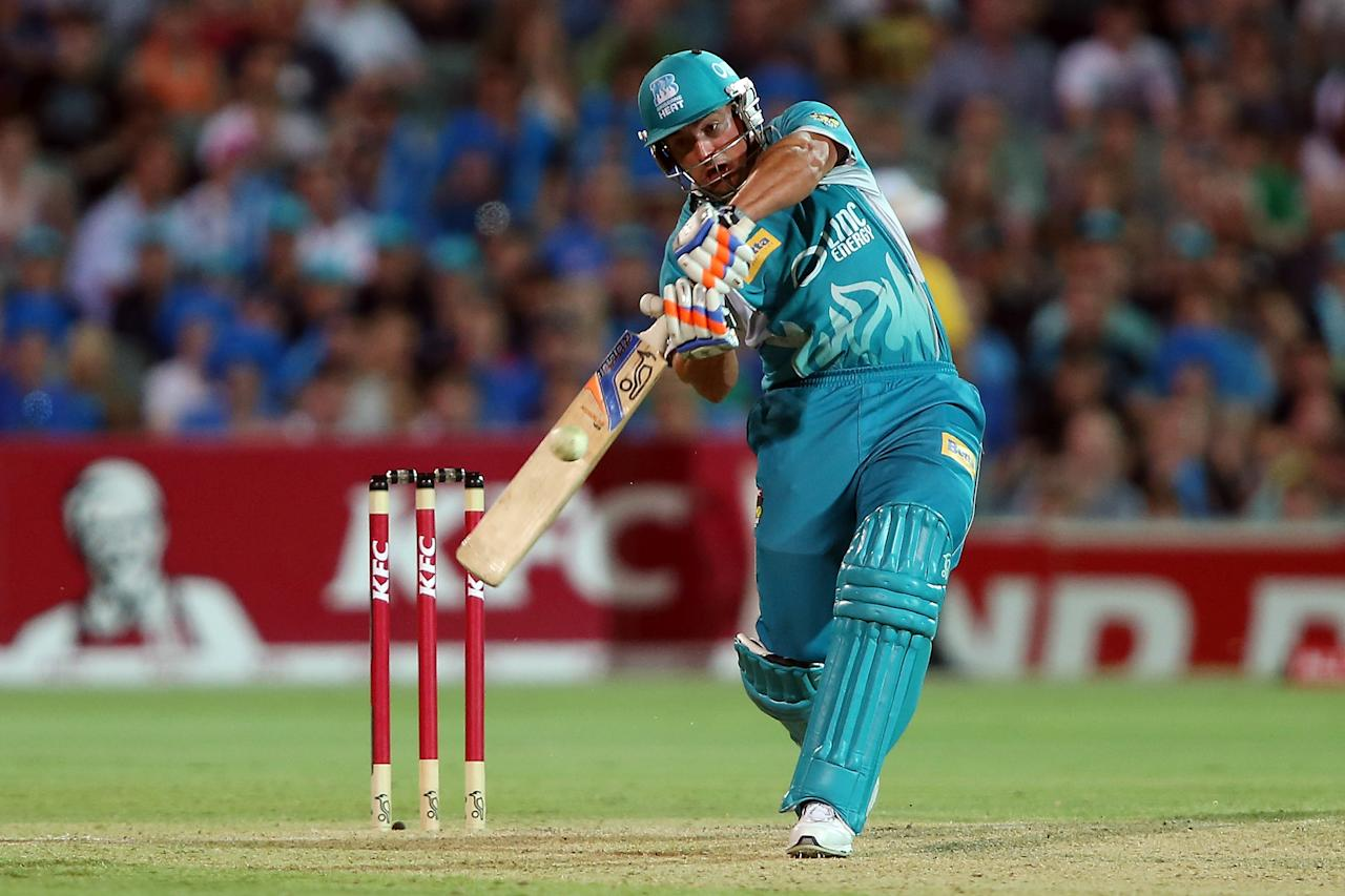 ADELAIDE, AUSTRALIA - DECEMBER 13: Peter Forrest of the Heat hits a boundary in the last over during the Big Bash League match between the Adelaide Strikers and the Brisbane Heat at Adelaide Oval on December 13, 2012 in Adelaide, Australia.  (Photo by Morne de Klerk/Getty Images)
