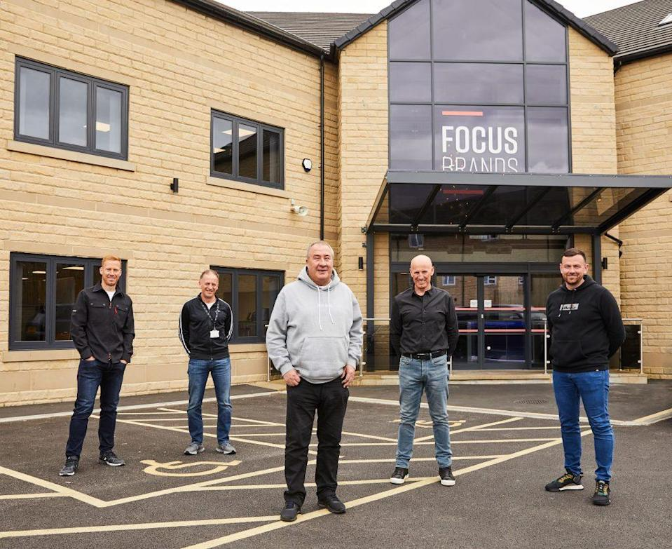 JD Sports executive chairman Peter Cowgill (center) pays a visit to Focus Brands' new headquarters in England. - Credit: Courtesy of Focus Brands