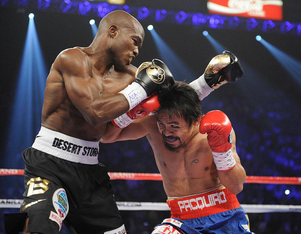 Manny Pacquiao, right, from the Philippines, and Timothy Bradley, from Palm Springs, Calif., trade blows in the first round of their WBO welterweight title fight Saturday, June 9, 2012, in Las Vegas.