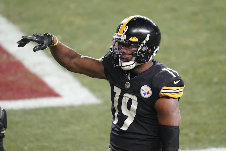 Pittsburgh Steelers wide receiver JuJu Smith-Schuster (19) celebrates after scoring on a 5-yard pass from quarterback Ben Roethlisberger during the second half of an NFL wild-card playoff football game against the Cleveland Browns, Sunday, Jan. 10, 2021, in Pittsburgh. (AP Photo/Keith Srakocic)