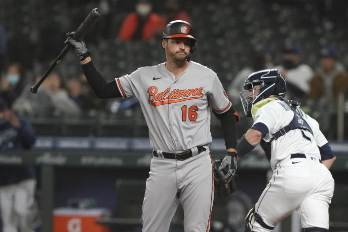 Baltimore Orioles' Trey Mancini (16) reacts after striking out swinging during the third inning of a baseball game against the Seattle Mariners, Monday, May 3, 2021, in Seattle. (AP Photo/Ted S. Warren)