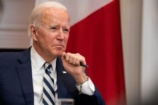 President Joe Biden, wearing his late son Beau's rosary on his left wrist, listens during a virtual meeting with Mexican President Andrés Manuel López Obrador in the Roosevelt Room of the White House on March 1, 2021 in Washington, DC.