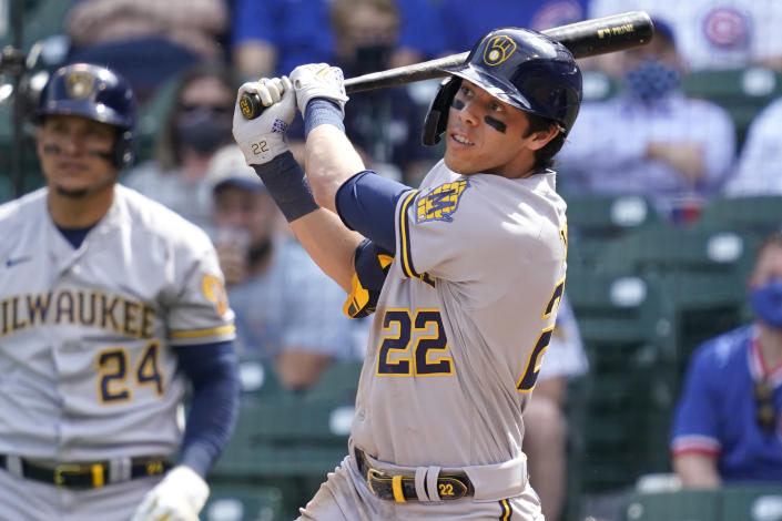 Milwaukee Brewers' Christian Yelich watches after hitting a double against the Chicago Cubs during the fourth inning of a baseball game in Chicago, Wednesday, April 7, 2021. (AP Photo/Nam Y. Huh)