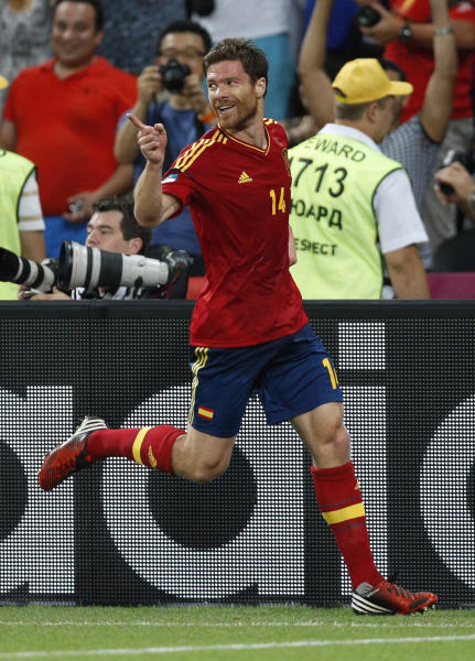 Spain's Xabi Alonso celebrates scoring the opening goal during the Euro 2012 soccer championship quarterfinal match between Spain and France in Donetsk, Ukraine, Saturday, June 23, 2012. (AP Photo/Michael Sohn)