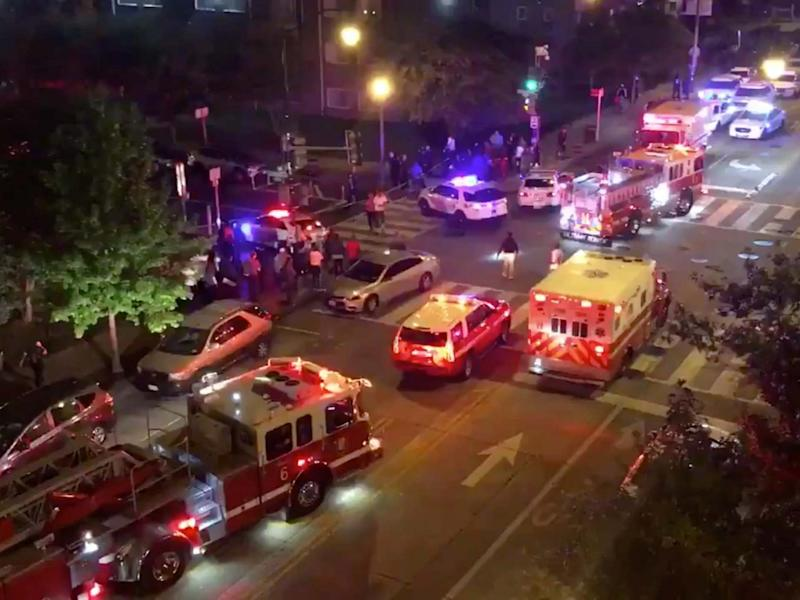 Rescue vehicles are seen following a shooting in Washington DC on 19 September: CHRIS G COLLISON via REUTERS