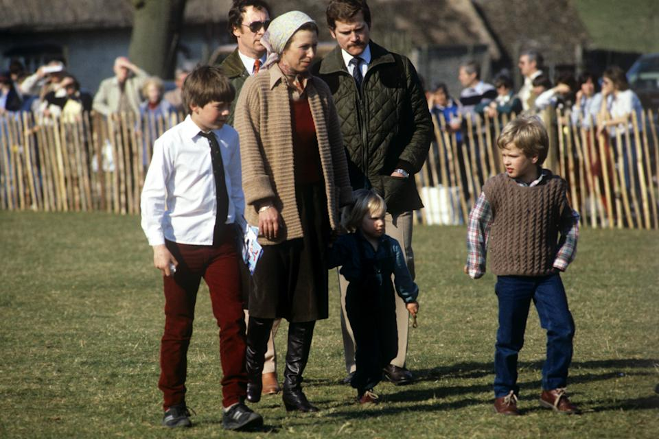 Princess Anne with her daughter Zara Phillips, nearly 3, and son Peter Phillips, 6, right, at the Badminton Horse Trials   (Photo by PA Images via Getty Images)