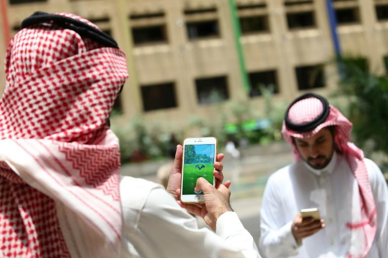 Saudi men play with the Pokemon Go application on their mobiles in the capital Riyadh on July 17, 2016