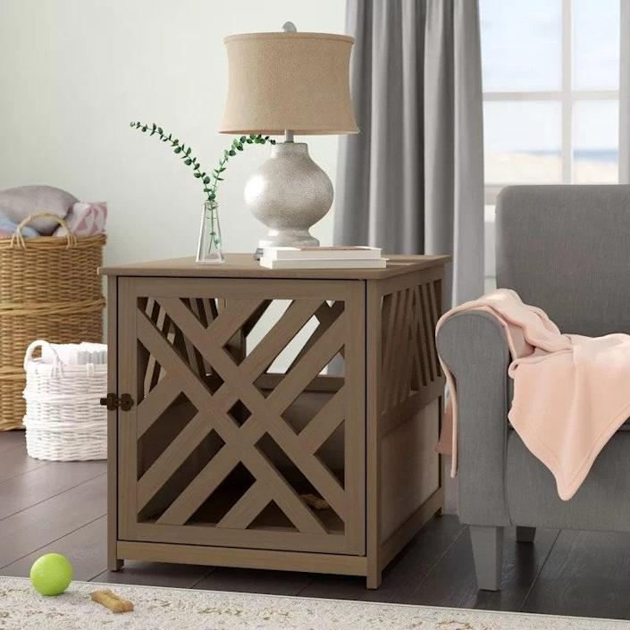 """Here's another crate that to the untrained eye could simply be a beautiful side table. The latticed design gives the space a contemporary look, while also allowing for plenty of light and ventilation. Bonus: The piece can be assembled without the door, if you'd prefer to have more of a dog house than a crate. And if your dog is extra large, it can withhold up to 300 pounds of pup. $180, Wayfair. <a href=""""https://www.wayfair.com/furniture/pdp/archie-oscar-menzel-modern-lattice-pet-crate-w005269714.html"""" rel=""""nofollow noopener"""" target=""""_blank"""" data-ylk=""""slk:Get it now!"""" class=""""link rapid-noclick-resp"""">Get it now!</a>"""