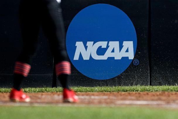 PHOTO: An athlete stands near an NCAA logo during a softball game in Beaumont, Texas, April 19, 2019. (Aaron M. Sprecher/AP, FILE)