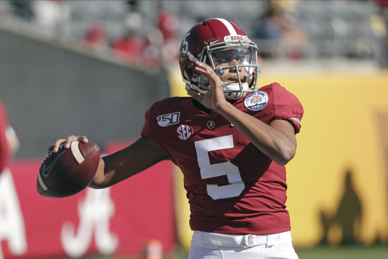 Alabama quarterback Taulia Tagovailoa (5) warms up before the Citrus Bowl NCAA college football game against Michigan, Wednesday, Jan. 1, 2020, in Orlando, Fla. (AP Photo/John Raoux)