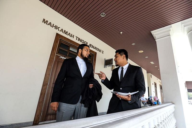 Mohamad Rafique (left) told the court that the desires of the 51,904 voters who cast their ballots in Tasek Gelugor should be of prime importance. — Picture by Sayuti Zainudin